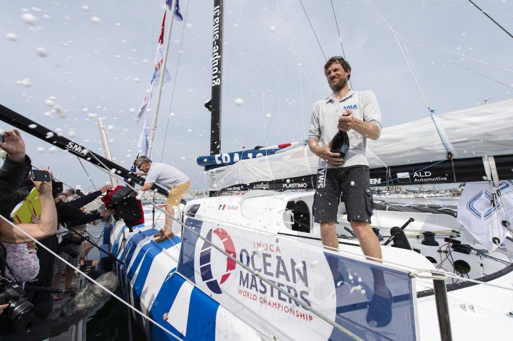 imoca-sma-skipper-paul-meilhat-fra-4th-place-celebration-with-champagne-during-the-arrival-of-the-transat-new-york-vendee-r-1600-1200